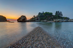 Isola Bella in Sicily at dusk Stock Images