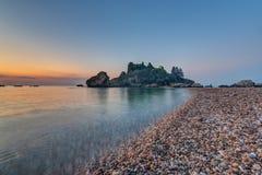 Isola Bella in Taormina at sunrise Stock Image