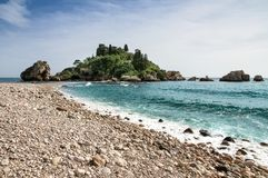 Isola Bella view in Taormina, Sicily, Italy. The beautiful small island with its beach pebbles and turquoise blue waters. Isola Bella view in Taormina, Sicily Stock Images