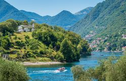 Comacina Island as seen from Ossuccio, on Lake Como, Lombardy, Italy. Isola Comacina is a small wooded island of Italy`s Lake Como, administratively a part of stock images