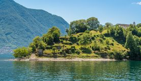 Comacina Island as seen from Ossuccio, on Lake Como, Lombardy, Italy. Isola Comacina is a small wooded island of Italy`s Lake Como, administratively a part of royalty free stock photos