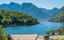 Comacina Island as seen from Ossuccio, on Lake Como, Lombardy, Italy. Isola Comacina is a small wooded island of Italy`s Lake Como, administratively a part of royalty free stock photography