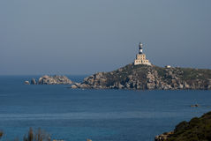 Isola dei Cavoli Lighthouse in Sardinia. Lighthouse in the small island off the south east corner of Sardegna (Italy). The island is found in the locality and Stock Photography