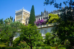 Isola del Garda. Looking up to the Venetian neo-Gothic style villa Stock Photo