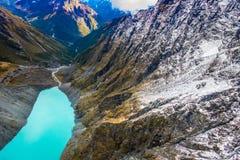 ISOLA DEL SUD, LA NUOVA ZELANDA 25 MAGGIO 2017: Bella laguna del turchese e del paesaggio, montagne vigorose coperte da neve Immagine Stock Libera da Diritti