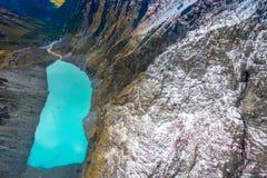 ISOLA DEL SUD, LA NUOVA ZELANDA 25 MAGGIO 2017: Bella laguna del turchese e del paesaggio, montagne vigorose coperte da neve Fotografia Stock
