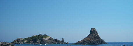 Isola e pila Immagini Stock