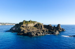 Isola Lachea. A few hundred yards from the Sicilian coast and Acitrezza, Isola Lachea is a deserted volcanic island and a tourist spot in the summer Stock Photo