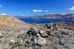 Isola vulcanica di Nea Kameni in Santorini, Grecia Fotografia Stock