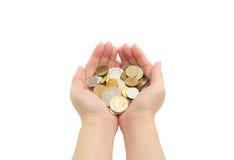 Isolado das mãos da mulher que guardam moedas Imagem de Stock Royalty Free