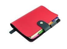 Isolado de couro vermelho do livro do diário no branco com trajeto de grampeamento Imagem de Stock
