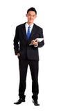 Isolado novo feliz de Using Digital Tablet do homem de negócios foto de stock