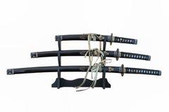 ` Isolado três s de Katana no suporte imagens de stock royalty free