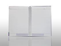 Isolamento do caderno com reflexão no fundo branco Fotos de Stock Royalty Free