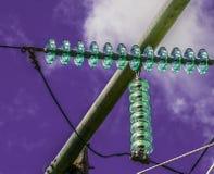 Isolanti dei piloni elettrici Immagine Stock