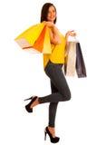 年轻愉快的微笑的妇女, isolat画象有购物袋的 免版税图库摄影