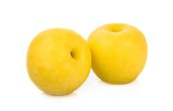 Isolat jaune de pomme sur le fond blanc Photo stock