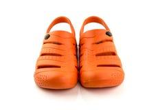 Isolat orange de chaussures sur le fond blanc Image stock