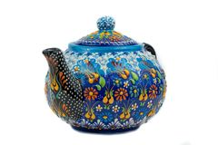 Isolate. bright ceramic teapot with patterns on white background stock image