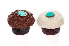 Isolate chocolate and vanilla sprinkles cupcakes Royalty Free Stock Images