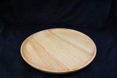 Isolate circle wood tray on black background. Isolate circle wood tray on black background, with work path royalty free stock image