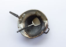 Isolate dirty old pan. Stock Image