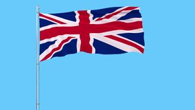 Isolate flag of United Kingdom on a flagpole fluttering in the wind on a blue background, 3d rendering. Isolate flag of United Kingdom on a flagpole fluttering stock video footage