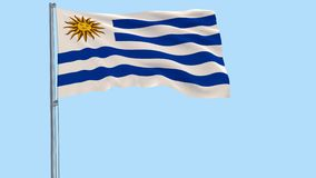 Isolate flag of Uruguay on a flagpole fluttering in the wind on a transparent background, 3d rendering, PNG format with ALPHA tran. Sparency stock video footage