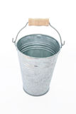 Isolate Grung rustic zinc bucket on white back ground with woode Stock Photography