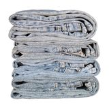 Isolate old jeans folded. Stock Photo