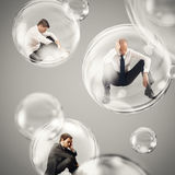 Isolate themselves inside a bubble. Sad businessmen flies in a bubbles. isolate themselves inside a bubbles detachment from the outside world concept Royalty Free Stock Images