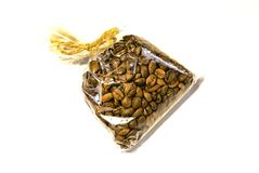 Transparent gift packaging of exquisite coffee, tied with a rope, twine stock images