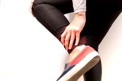 The isolate of women ankle knee painful/injury Royalty Free Stock Photo
