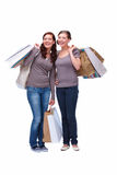 Isolate of young happy shoppers carrying shopping Royalty Free Stock Images