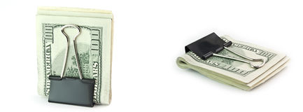The isolated 100 dollar in a clip. The isolated pile of 100 dollar denominations in a writing clip Stock Photography