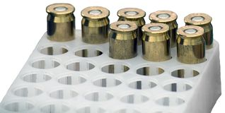 Isolated, 45 Caliber Bullets. Bullets of .45 caliber in a plast casing. Isolated over white Royalty Free Stock Image