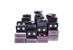 Isolated abandoned pile of old useless mini DV royalty free stock image