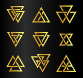 Isolated abstract golden color triangles contour logo set on black background, geometric triangular shape logotype Stock Photo