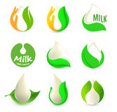 Isolated abstract white drop of milk in green fresh leaf and orange palm logo set. Dairy products logotype collection Royalty Free Stock Photo