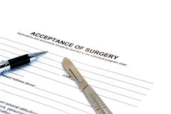 Acceptance of surgery form hospital law pen Isolat. Isolated acceptance of surgery form with scalpel and pen on white Royalty Free Stock Photos