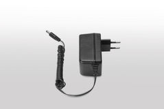 Isolated adapter. Isolated black adapter on white background Stock Images