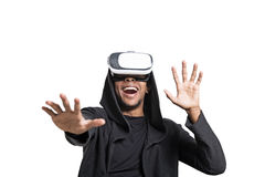 Isolated African American man in vr glasses. Isolated portrait of an African American young man in a hoodie wearing vr glasses and playing a video game. Mock up royalty free stock photo