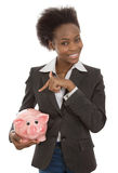 Isolated afro american businesswoman with piggy bank: money conc Royalty Free Stock Photo
