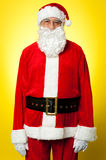 Isolated aged male dresses in Santa attire Stock Image
