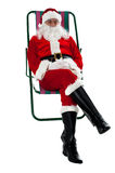 Isolated aged Santa relaxing. Vacation time Royalty Free Stock Photo