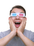 Isolated amazed young man with 3d anaglyph glasses Royalty Free Stock Photos