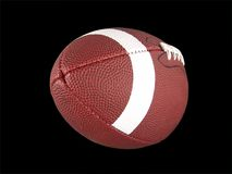 Isolated American Football. High resolution digital photo of an American football close up. Isolated on digital black background. Can be easily incorporated into royalty free stock photography