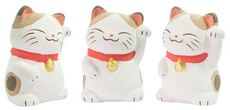 White ceramic japanese cat doll. Isolated 3 angles of white ceramic japanese cat doll stock photos