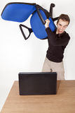 Angry man with chair Royalty Free Stock Photo