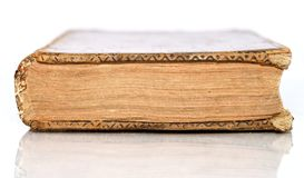 Isolated Antique Book. Old Book lying down flat isolated by white Royalty Free Stock Photo